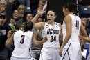 Connecticut guard Tiffany Hayes (3), guard Kelly Faris (34) and center Kiah Stokes (41) celebrate a last-second basket during the first half of the NCAA women's college basketball tournament regional final in Kingston, R.I., Tuesday, March 27, 2012. Connecticut defeated Kentucky 80-65.