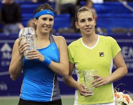 Sofia Arvidsson, Left, Of Sweden, Holds Her Winner's Trophy And  Marina Erakovic, Right, Of New Zealand, Holds Her
