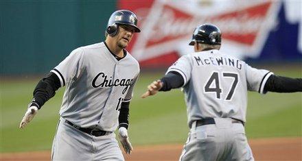 Chicago White Sox Catcher A.J. Pierzynski, Left, Is