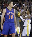 Golden State Warriors ' Monta Ellis , right, celebrates in the final minuteof an NBA basketball game as New York Knicks Steve Novak (16) looks on Wednesday, Dec. 28, 2011, in Oakland, Calif.