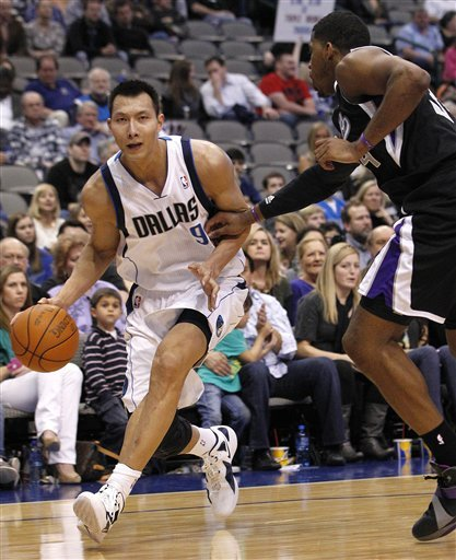 Dallas Mavericks Power Forward Yi Jianlian (9) Of China Dribbles Against Sacramento Kings Center Jason Thompson (34)