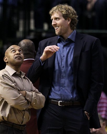 The Dallas Mavericks' Dirk Nowitzki, Right, Of Germany Stands