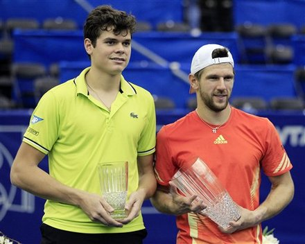 Milos Raonic, Left, Of Canada, And Jurgen Melzer, Right, Of Austria, Pose With Their Trophies