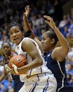Duke Richa Jackson (15) eyes the basket around Connecticut's Kaleena Mosqueda-Lewis (23) during the first half of an NCAA women's college basketball game, Monday, Jan. 30, 2012, in Durham, N.C. Connecticut won 61-45.
