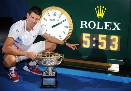 Serbia's Novak Djokovic Poses For A Photo Of A Clock Showing The Match Time Of His Final Against Spain's Rafael Nadal