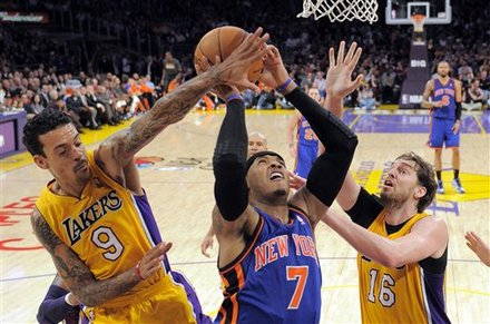 New York Knicks Forward Carmelo Anthony, Center, Goes Up For A Shot As Los Angeles Lakers Forward Matt Barnes, Left,