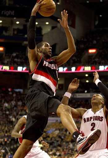 Portland Trail Blazers Forward LaMarcus Aldridge, Left,  Drives To The Hoop Past Toronto Raptors Forward James Johnson (