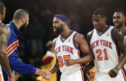 New York Knicks Center Tyson Chandler, Far Left, Greets