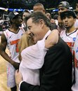 Louisville coach Rick Pitino hugs his wife, Joanne Minardi, after their win against Florida in a NCAA tournament West Regional final college basketball game, Saturday, March 24, 2012, in Phoenix.