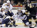 Boston Bruins ' Chris Kelly (23) tries to get a shot off in front of Nashville Predators ' goalie Pekka Rinne (35) as the Predators' Ryan Suter (20) defends in the third period of an NHL hockey game in Boston, Saturday, Feb. 11, 2012. The Bruins won 4-3 in a shootout.