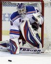 New York Rangers goalie Henrik Lundqvist of Sweden, follows the puck during the first period of an NHL hockey game against the Buffalo Sabres in Buffalo, N.Y., Wednesday, Feb. 1, 2012. The Rangers won 1-0 in a shootout.
