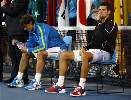 Novak Djokovic Of Serbia, Right, And Rafael Nadal Of Spain Take A Drink