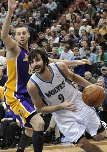 Minnesota Timberwolves' Ricky Rubio, Right, Drives