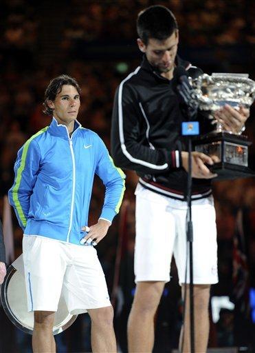 Rafael Nadal Of Spain, Left, Looks