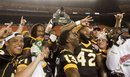 Members of the Southern Mississippi football team hold up the Hawaii Bowl trophy celebrating their win over Nevada after an NCAA college football game, Saturday, Dec. 24, 2011, in Honolulu. Southern Miss defeated Nevada 24-17 to win the 2011 Sheraton Hawaii Bowl.