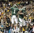 Baylor's Terrance Ganaway , right, and Kendall Wright celebrate a touchdown during the second half of the Alamo Bowl college football game against Washington , Thursday, Dec. 29, 2011, at the Alamodome in San Antonio. Baylor pulled out a thrilling Alamo Bowl victory in the highest-scoring bowl game in history, beating Washington 67-56 in a record-smashing shootout Thursday night.