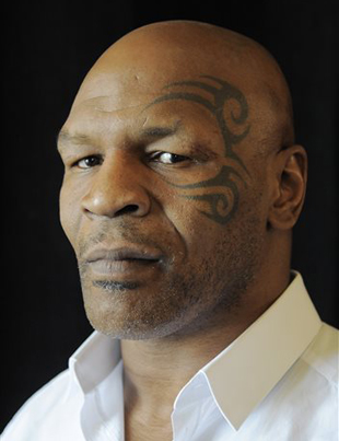 Mike Tyson makes an up-and-down debut in first news conference as a boxing promoter