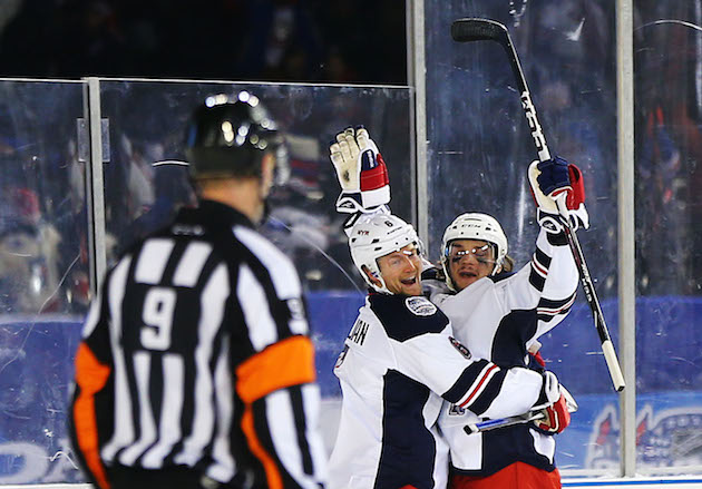 Daniel Carcillo's goal helps Rangers edge Islanders 2-1 at Yankee Stadium