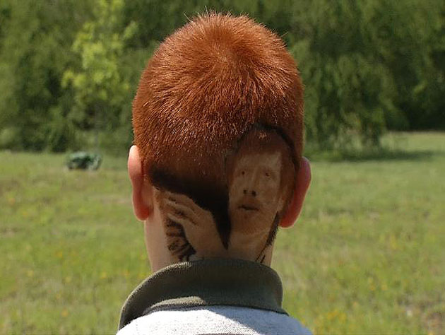 Freed from his school's rules, that young Spurs fan has shaved Matt Bonner back into his head again