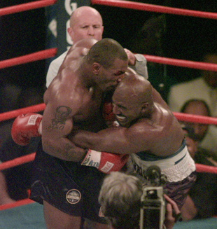 Evander Holyfield wanted to bite Mike Tyson to get even when Tyson bit him in 1997 title bout