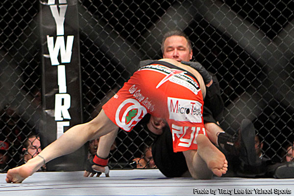 Photo: Jon Fitch wrestles referee after UFC 141 knockout