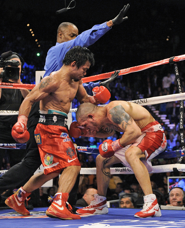 Manny Pacquiao puts on 'true poker face' regarding Nov. 10 opponent, promoter says