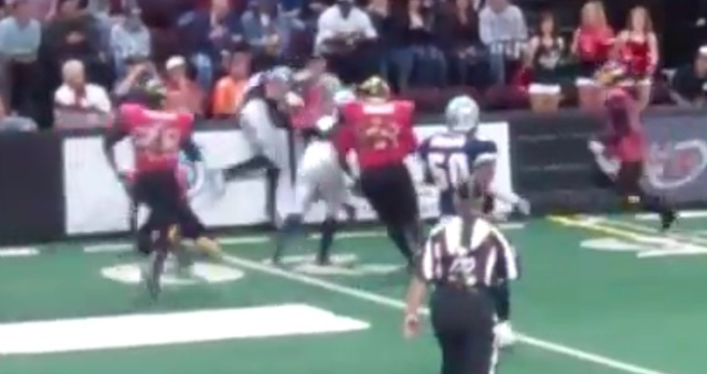 Terrell Owens gets tackled over a wall in IFL game (video)