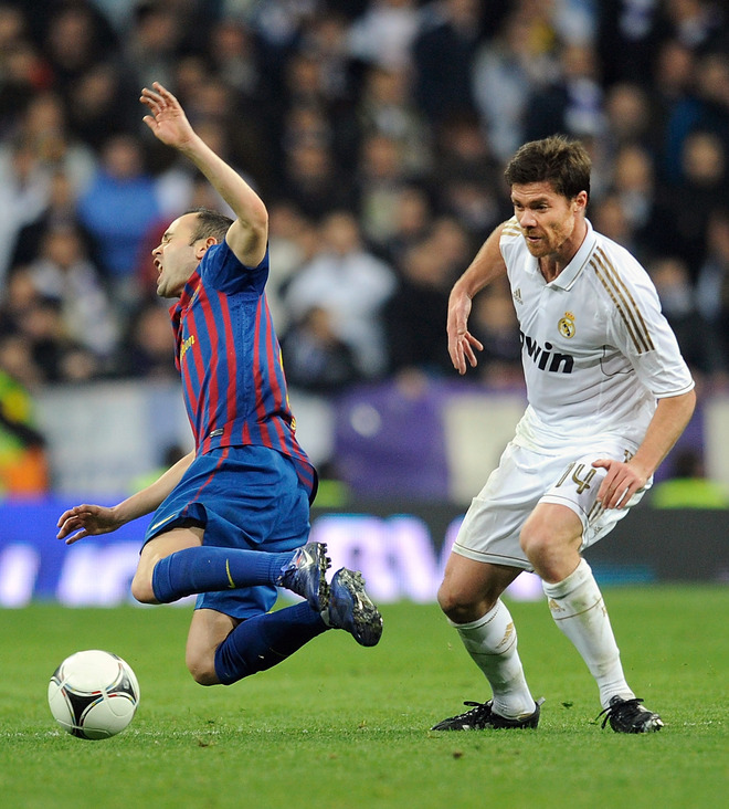 Xabi Alonso (R) Of Real Madrid Fouls