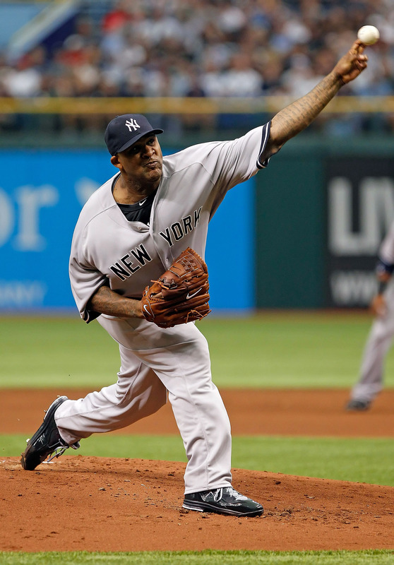 Pitcher CC Sabathia #52 Of The New York Yankees Pitches