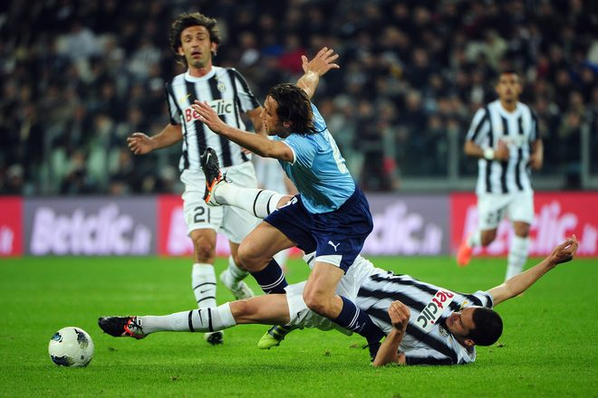 TURIN, ITALY - APRIL 11:  Lazio's midfielder Stefano Mauri (L) fights for the ball with Juventus' defender Leonardo Bonucci during the Italian Serie A football match Juventus against Lazio on April 11, 2012 in Juventus stadium.  (Photo by Olivier Morin/AFP/Getty Images)