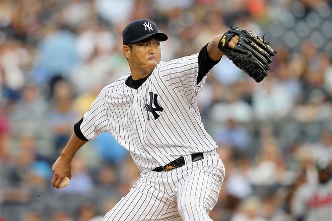 Hiroki Kuroda #18 Of The New York Yankees Pitches