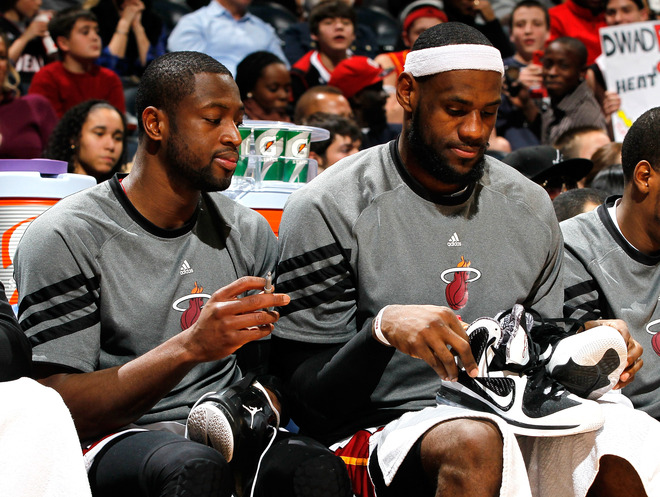 Dwyane Wade #3 And LeBron James #6 Of The Miami Heat Autograph Their Shoes