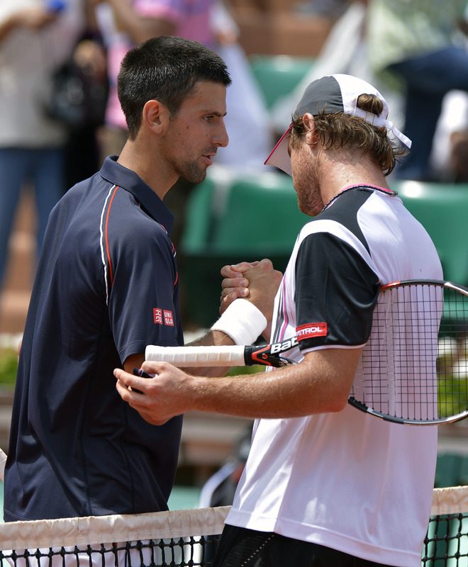 Serbia's Novak Djokovic (L) Shakes