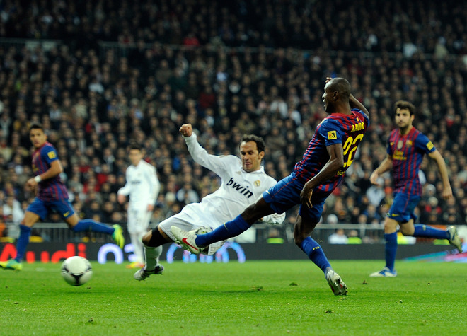 Barcelona's French Defender Eric Abidal (R) Shoots