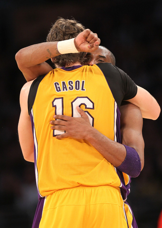 Pau Gasol #16 And Kobe Bryant #24 Of  The Los Angeles Lakers Emnbrace