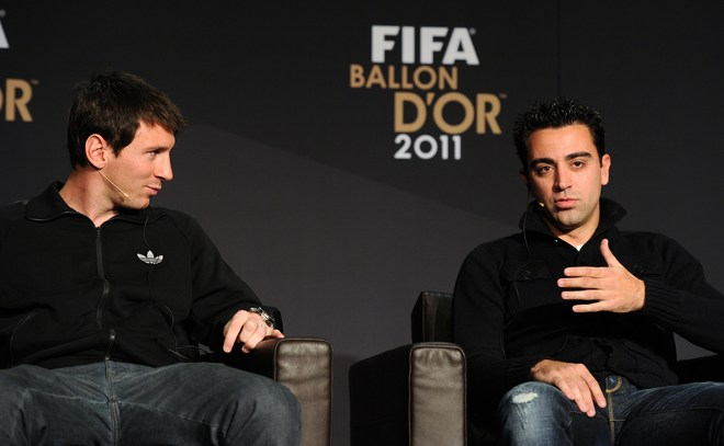 Nominees For The FIFA Ballon D'Or, Barcelona's Argentinian Forward Lionel Messi (L) And Barcelona's Midfielder Xavi