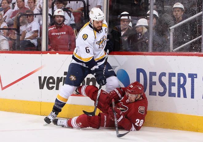 Shea Weber #6 Of The Nashville Predators Lays A Check Onto Lauri Korpikoski #28 Of The Phoenix Coyotes In The First
