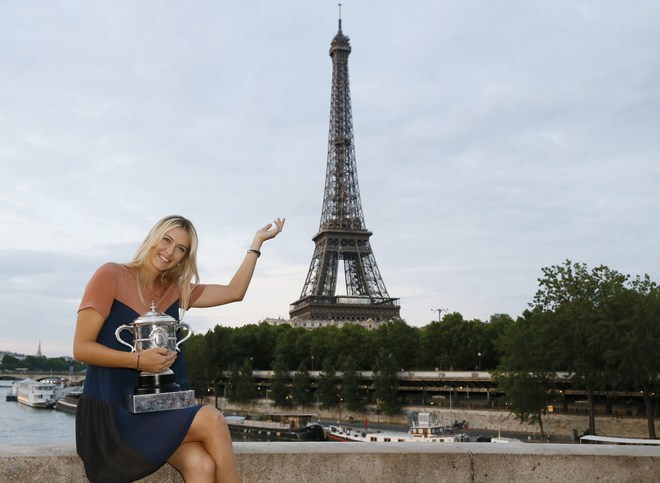 TOPSHOTSRussian Tennis Player Maria Sharapova Poses With Her Trophy In Front The Eiffel Tower On June 9, 2012 In Paris,