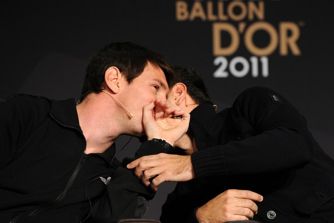 Nominees For The FIFA Ballon D'Or, Barcelona's Argentinian Forward Lionel Messi (L) Speaks With Barcelona's Midfielder