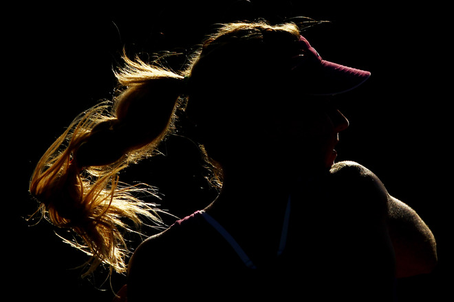 Maria Kirilenko Of Russia Playing With Doubles Partner Nadia Petrova Of Russia Returns A Shot Against  Su Wei Hsieh