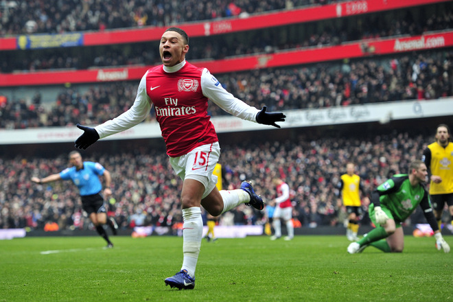 Arsenal's English Striker Alex Oxlade-Chamberlain Celebrates Scoring Their Third Goal   RESTRICTED TO EDITORIAL USE. No
