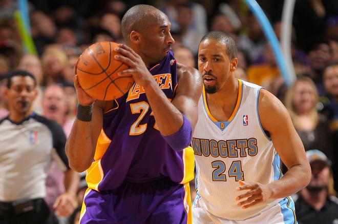 Kobe Bryant #24 Of The Los Angeles Lakers Bites