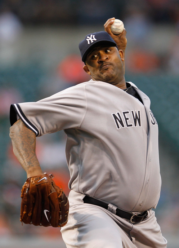 Starting Pitcher CC Sabathia #52 Of The New York Yankees Throws