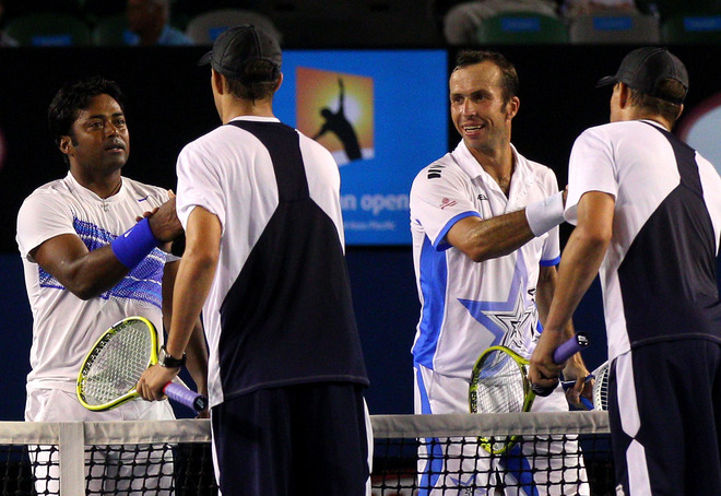 Leander Paes Of India (L) And Radek Stepanek Of Czech Republic (2R) Shake Hands
