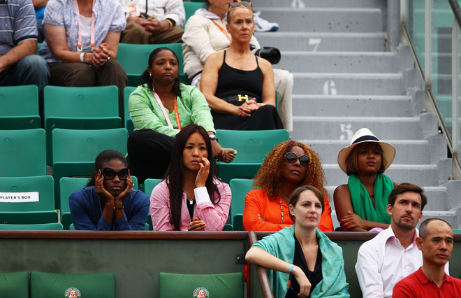 Oracene Price Watches The Women's Singles Second Round Match Between Agnieszka Radwanska Of Poland And Venus Williams