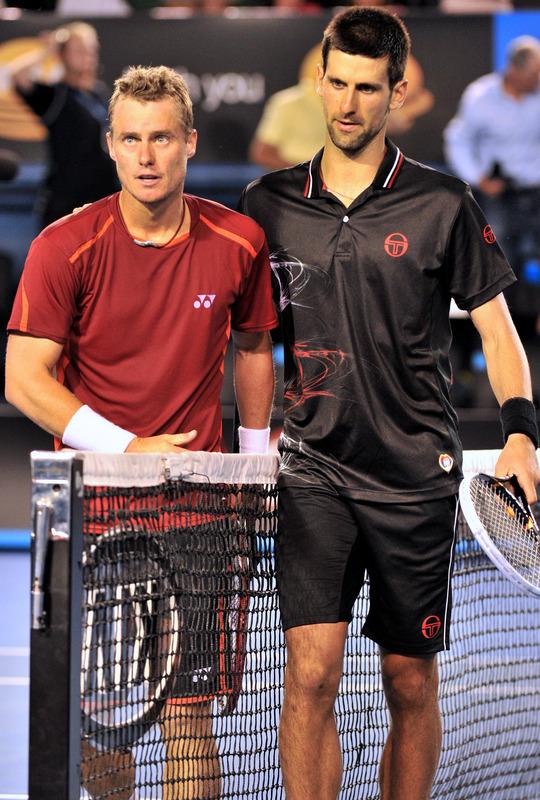 Novak Djokovic Of Serbia (R) Walks
