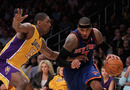 LOS ANGELES, CA - DECEMBER 29:  Carmelo Anthony #7 of the New York Knicks is defended by Metta World Peace #15 of the Los Angeles Lakers during the second half at Staples Center on December 29, 2011 in Los Angeles, California. The Lakers defeated the Knicks 99-82. NOTE TO USER: User expressly acknowledges and agrees that, by downloading and or using this photograph, User is consenting to the terms and conditions of the Getty Images License Agreement.  (Photo by Jeff Gross/Getty Images)