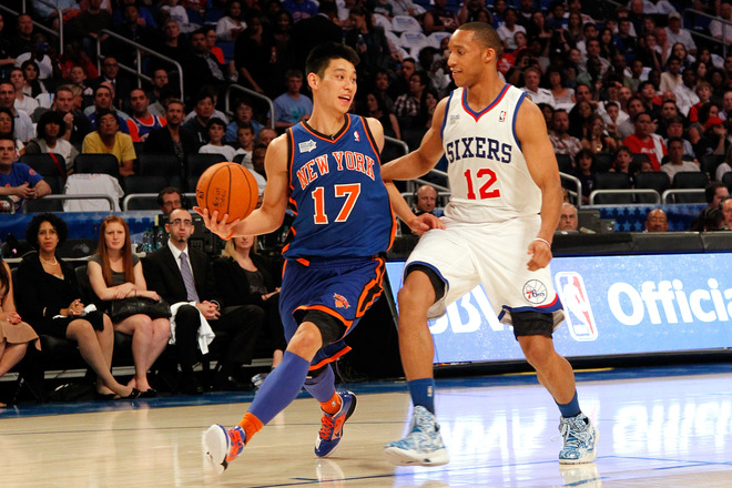 Jeremy Lin #17 Of The New York Knicks And Team Shaq Drives Against Evan Turner #12 Of The Philadelphia 76ers And Team
