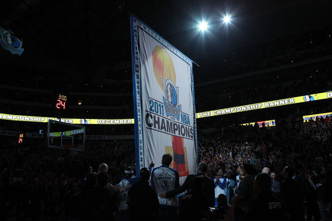 The Dallas Mavericks Raise The 2011 NBA Championship Banner