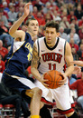 LAS VEGAS, NV - DECEMBER 23: Carlos Lopez #11 of the UNLV Rebels drives against David Kravish #45 of the California Golden Bears during their game at the Thomas & Mack Center December 23, 2011 in Las Vegas, Nevada. UNLV won 85-68. (Photo by Ethan Miller/Getty Images)
